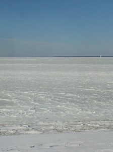 Beach at bottom edge.  Ice out to lighthouse!